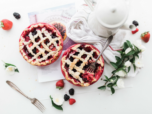 berry pies and tea on table